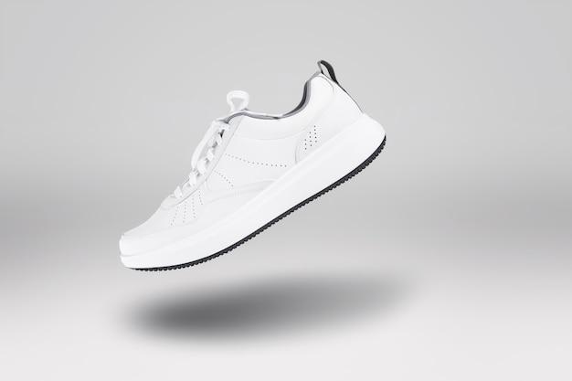 Floating shoe on gray background street style fashion