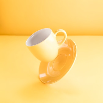 A floating yellow coffee cup