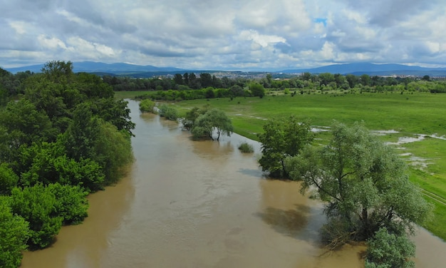 Flooded field with farm after heavy rains storm
