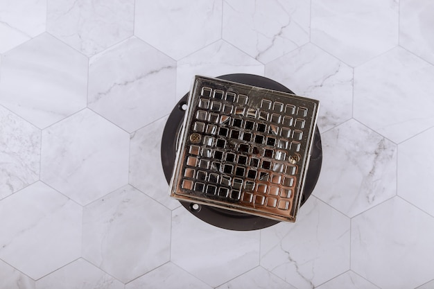 Floor drain from modern shower in cover is stainless steel, drain cover