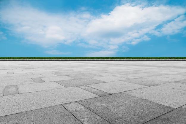 床タイル地面と青い空と白い雲