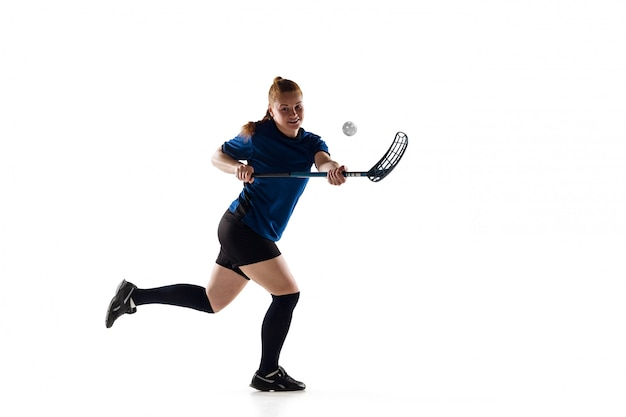 Floorball female player isolated on white, action and motion concept