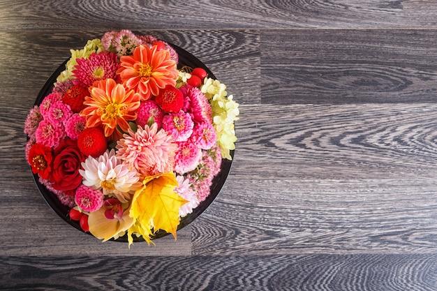Floral arrangement of autumn flowers on a plate