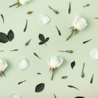 Floral arrangement of roses on green background