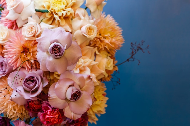 Floral arrangement with roses, asters, dahlias, and carnations