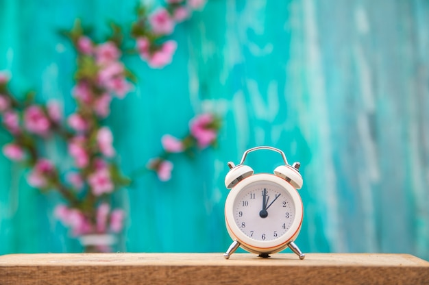 Floral background for text and a white clock.