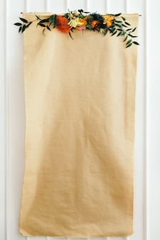 Floral blank craft paper poster on a white wall
