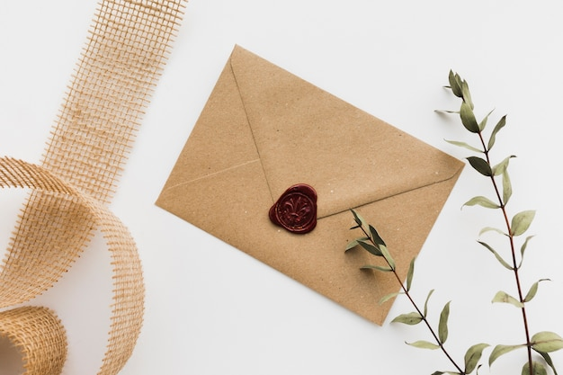 Floral branch with wedding invitation