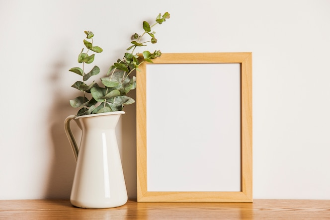 Floral composition with frame next to plant