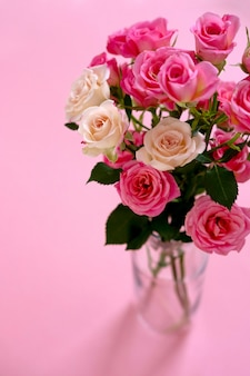 Floral composition with a pink roses on pink. valentine's day concept