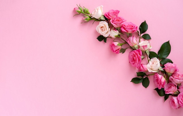 Floral composition with a wreath of pink roses on pink background. valentine's day background. flat lay, top view.