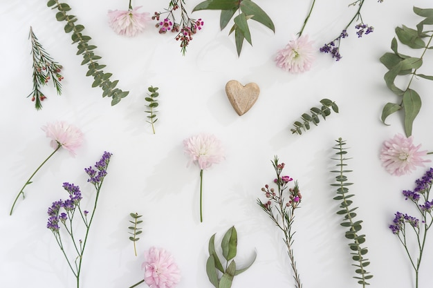 Floral decoration with heart on white background