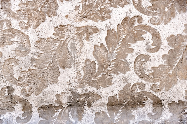 Floral design as background engraved in stone.