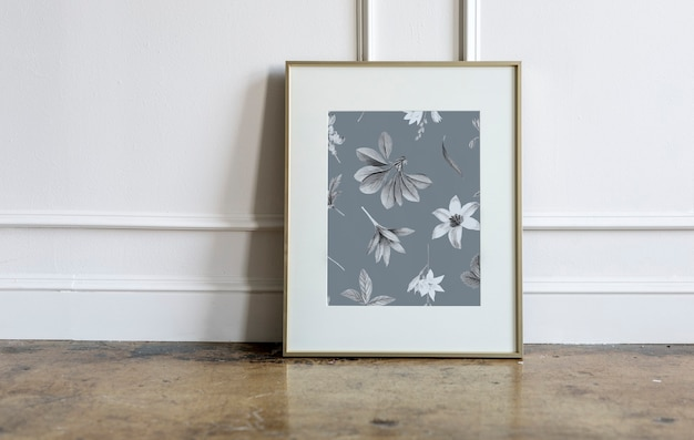 Floral frame against a white wall