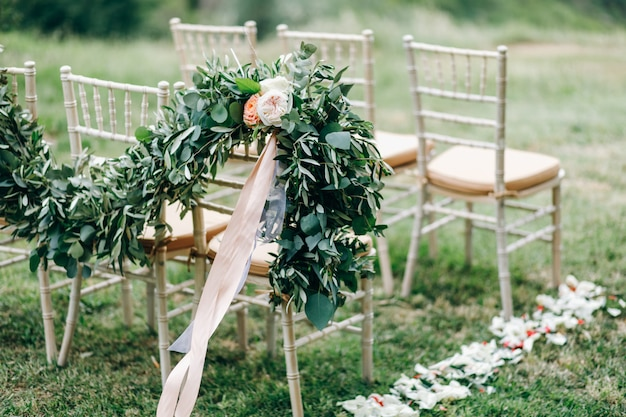 Floral garlands of green eucalyptus and pink flowers decorate we
