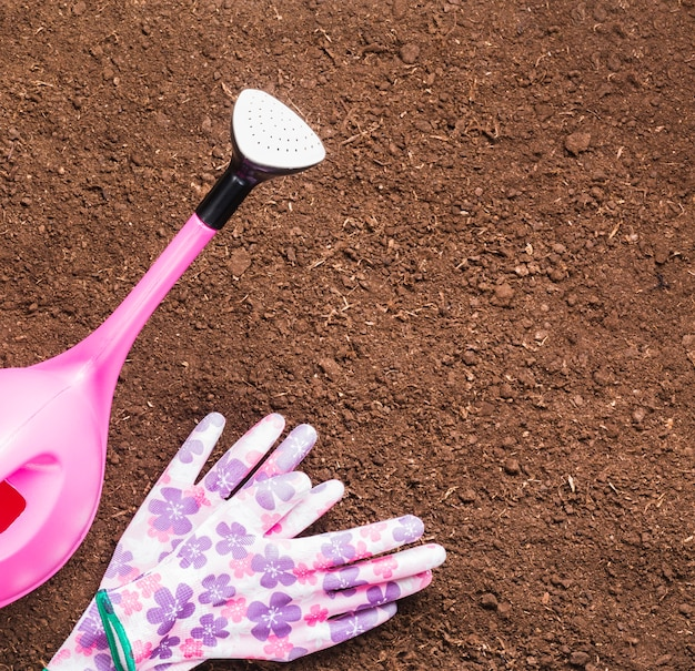 Floral gloves and watering can