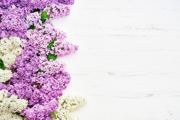 Floral pattern of pink lilac branches, flowers background. flat lay, top view.