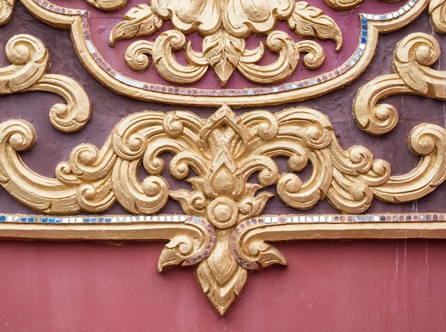 Floral pattern stucco in the traditional thai style.