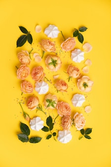 Floral pattern with pink roses and merengues on yellow