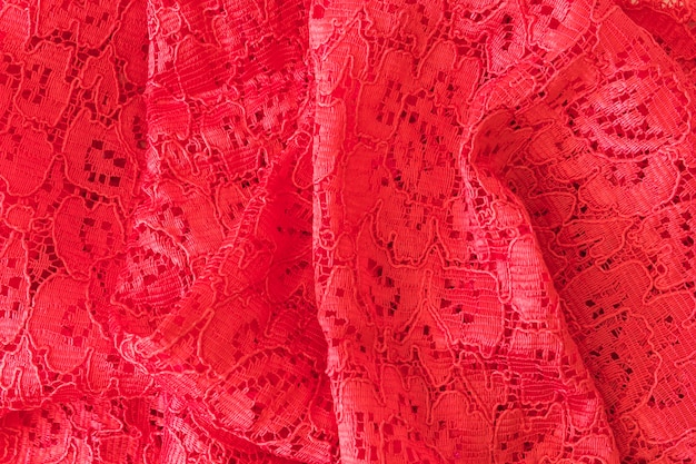 Floral red lace fabric textured backdrop
