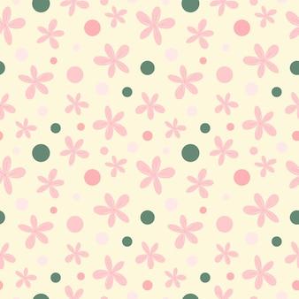 アイボリーの背景に花のシームレスなパターン。ピンクの花、緑のドットが繰り返し印刷されます。テキスタイル、ファブリック、壁紙、包装紙、装飾用のかわいい手描きの飾り。