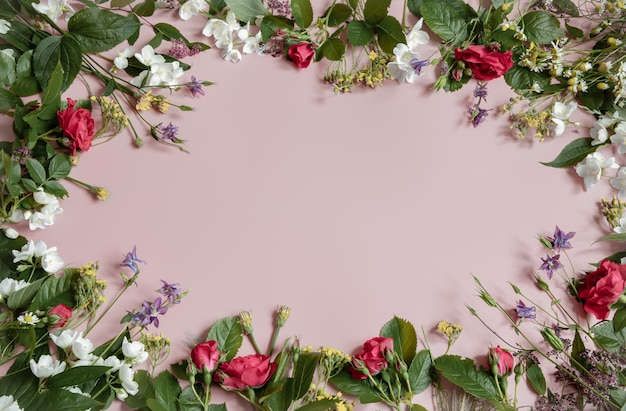 Floral surface with fresh natural flowers at the edges copy space