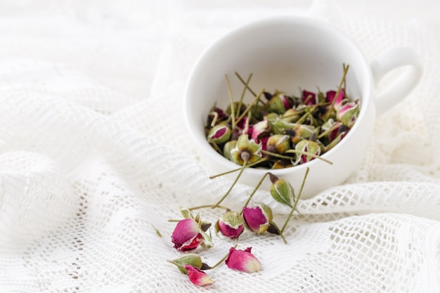 Floral tea with rose hips in bowl