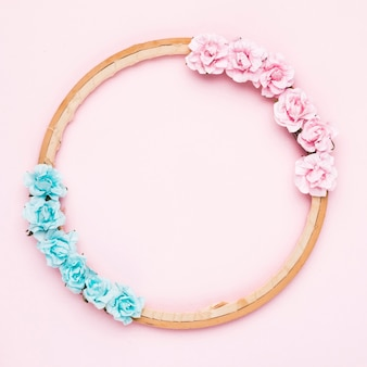 Floral wooden frame on pink background