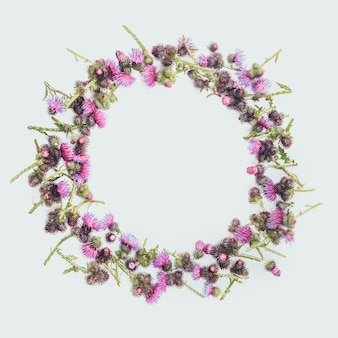 Floral wreath made of green branches of thistle