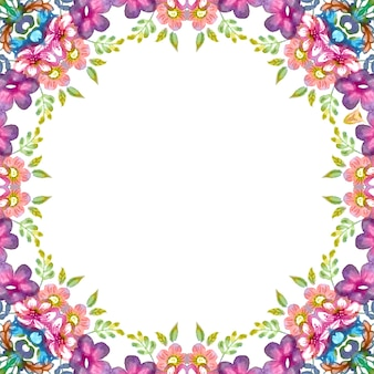 Floral wreath with colorful spring and summer flowers and green leaves.