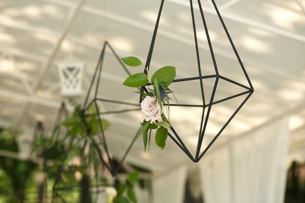 Florarium with fresh succulent and rose flowers festive table decoration. wedding banquet design