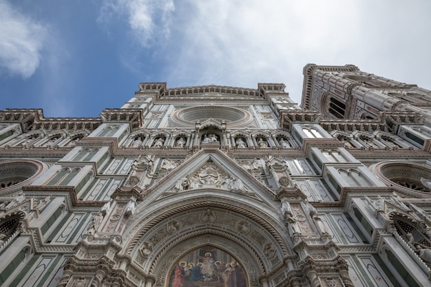 Florence, italy - june 24, 2018: closeup view of facade of cattedrale di santa maria del fiore (cathedral of saint mary of the flower) is the cathedral of florence