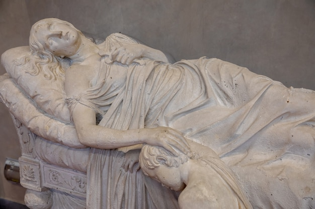 Florence, italy - june 24, 2018: closeup view of marble sculpture by italian artist in academy of fine arts of florence (accademia di belle arti di firenze)