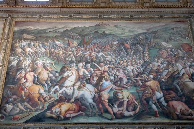 플로렌스, 이탈리아 - 2018년 6월 24일: 베키오 궁전(고궁)에서 이탈리아 예술가들의 사진을 클로즈업한 모습은 피렌체 시청입니다.