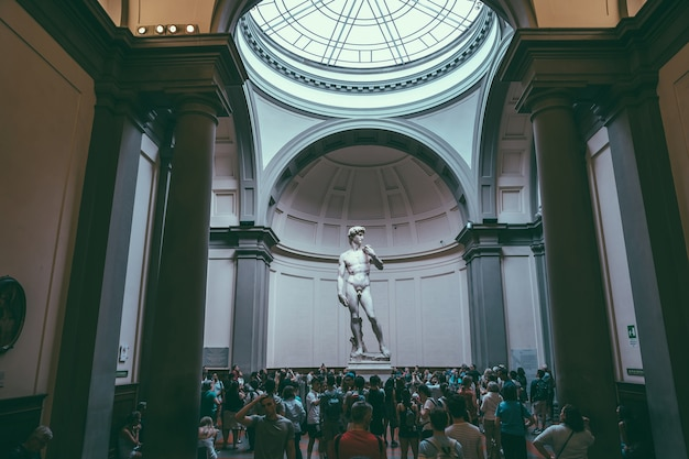Florence, italy - june 24, 2018: panoramic view of hall with sculpture is david by italian artist michelangelo, created in between 1501 and 1504 in academy of fine arts of florence