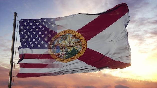 깃대에 플로리다와 미국 플래그입니다. 바람에 물결 치는 미국 및 플로리다 혼합 깃발