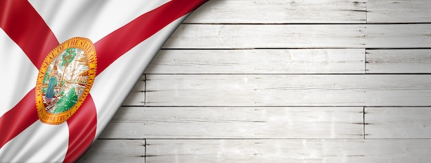 Florida flag on white wood wall banner, usa. 3d illustration