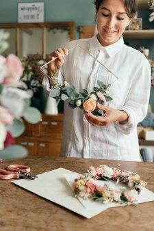 Florist arranging a bouquet of flower