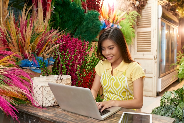 Florist checking online orders