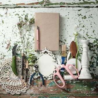 Florist desktop with working tools and ribbons