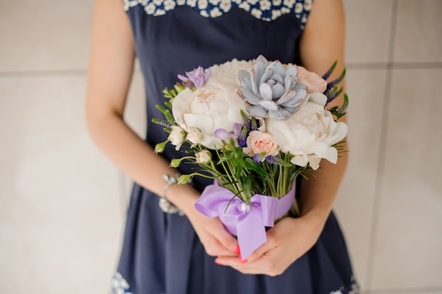 Florist holding beautiful bouquet of flowers no face