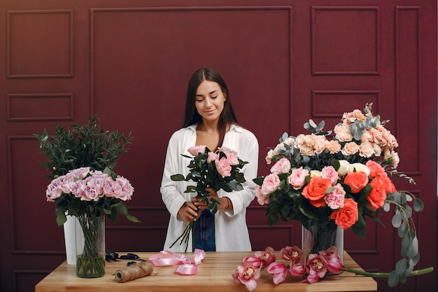 Florist makes a beautiful bouquet in a studio