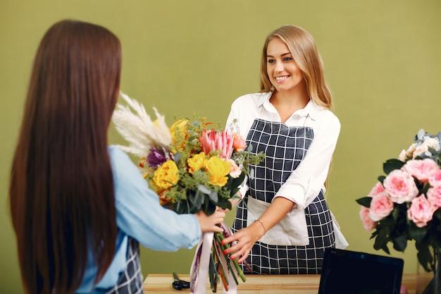 Florist makes a beautiful bouquet in a studio