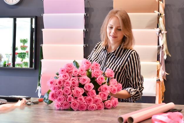 Florist making a floral arrangement.