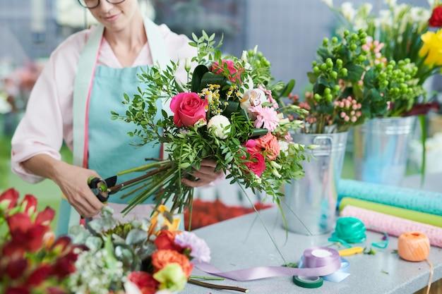 Florist making flower bouquet