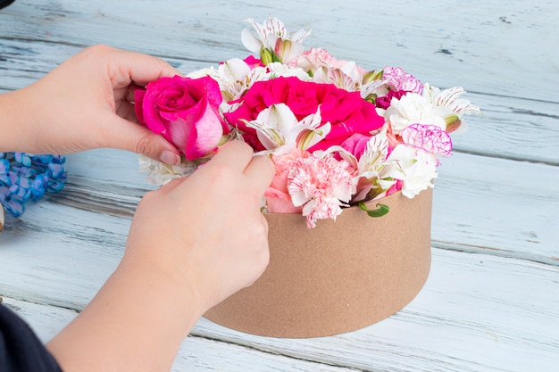 Florist preparing a bouquet of pink and red roses