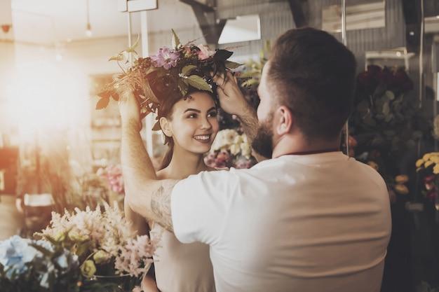 Florist puts a flower wreath on the girl's head