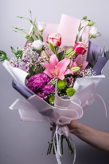 Florist's work in the process of creating a bouquet