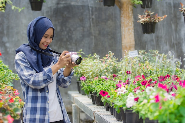 Florist taking photos with camera