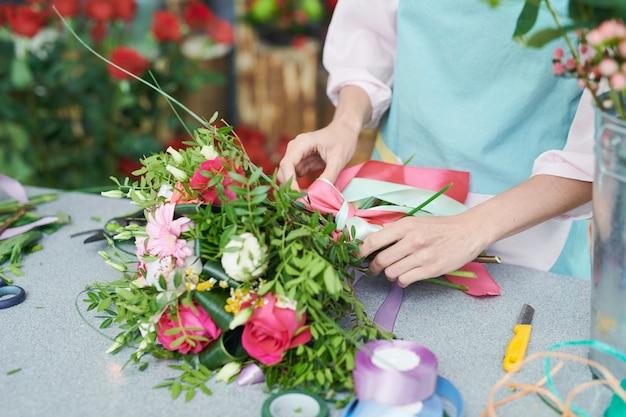 Florist tying boquet